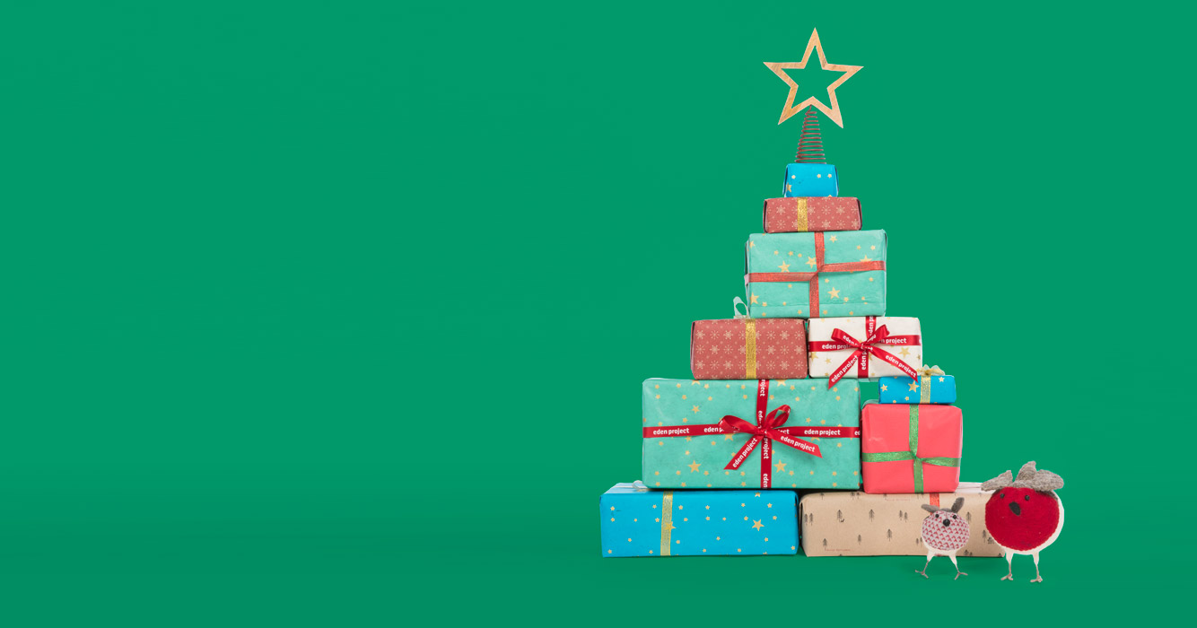 https://www.edenproject.com/shop/sites/default/files/revslider/image/christmas-tree-present-stack-2.jpg
