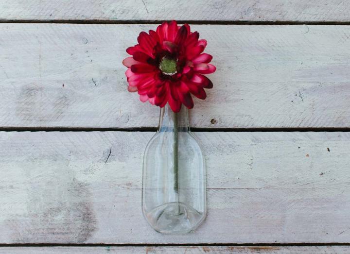 Recycled glass juice bottle bud vase
