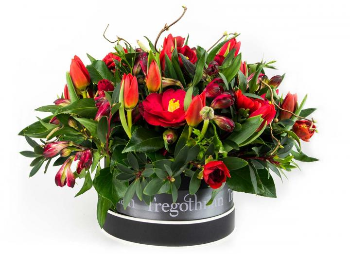 Rich red hat box valentine's day bouquet hand-tied by Tregothnan