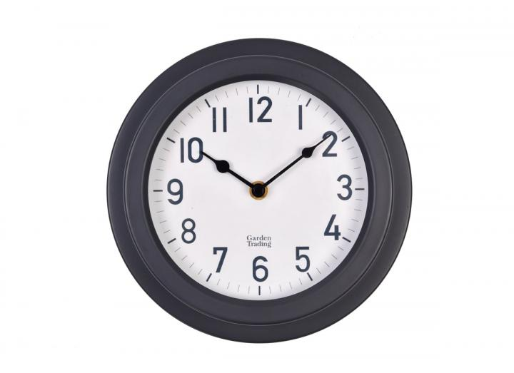 Tenby powder coated steel clock in carbon from Garden Trading