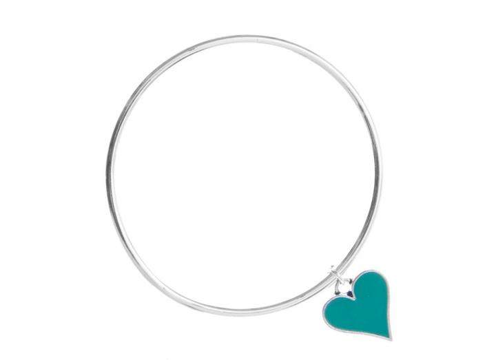 Silver bangle with green heart charm