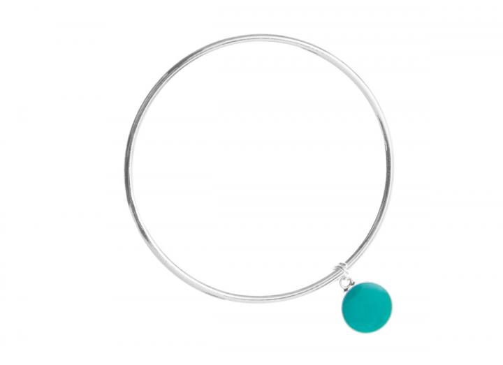 Silver bangle with green circle charm