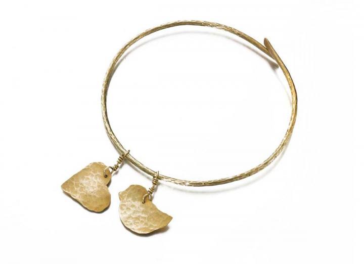 Brass lovebird and heart bangle