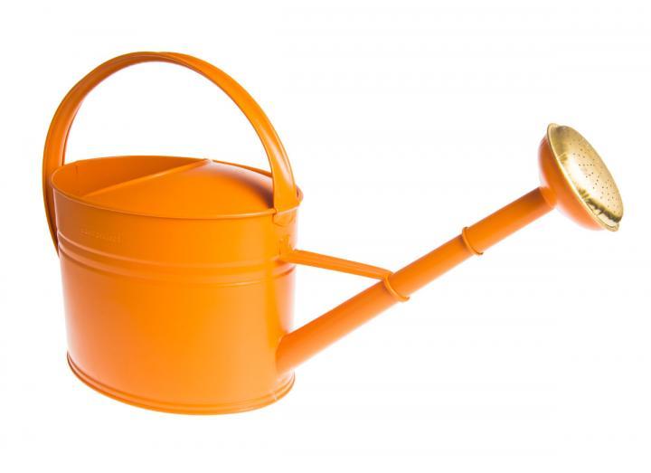 Oval orange metal watering can