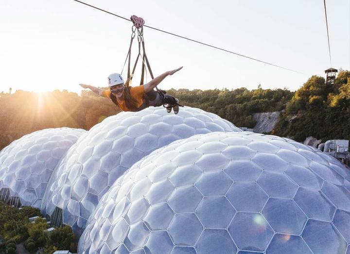 Woman on zip wire over the Eden Project