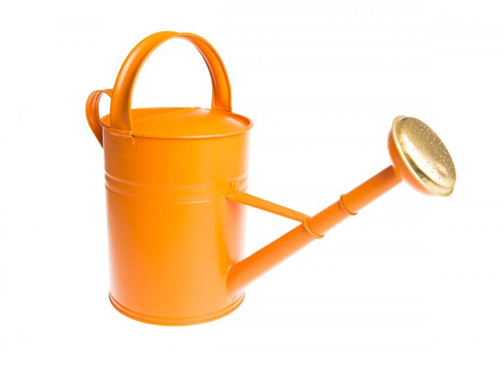 Tall orange metal watering can