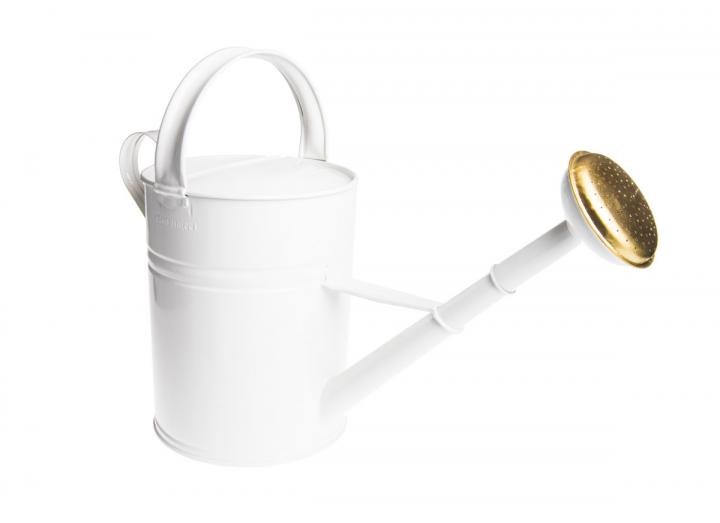 Tall white metal watering can